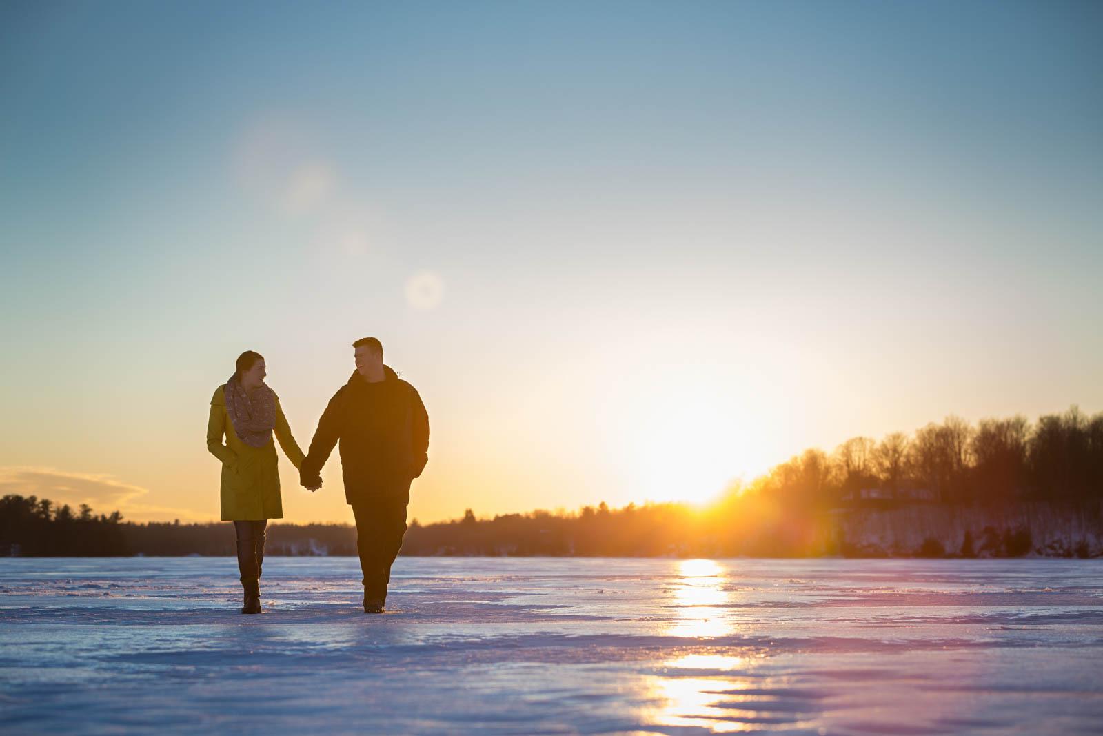 Winter sunset frozen lake engagement session at Perth Rideau Lakes Murphys Point Provincial Park