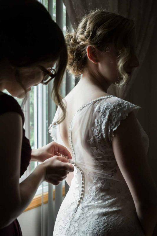 Pixelicious Erika and Simon wedding preparation putting on dress