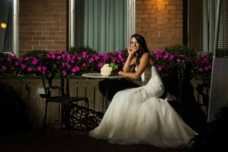 Bride sitting down showing dress
