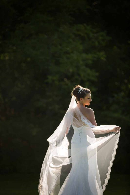 Bride showing off veil