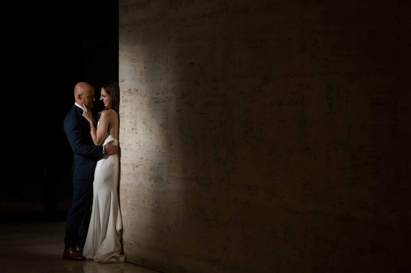 Couple against a wall during reception