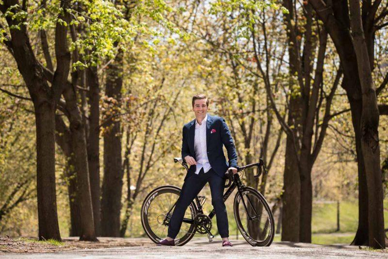 Riding bikes at La Fontaine Park Montreal engagement session