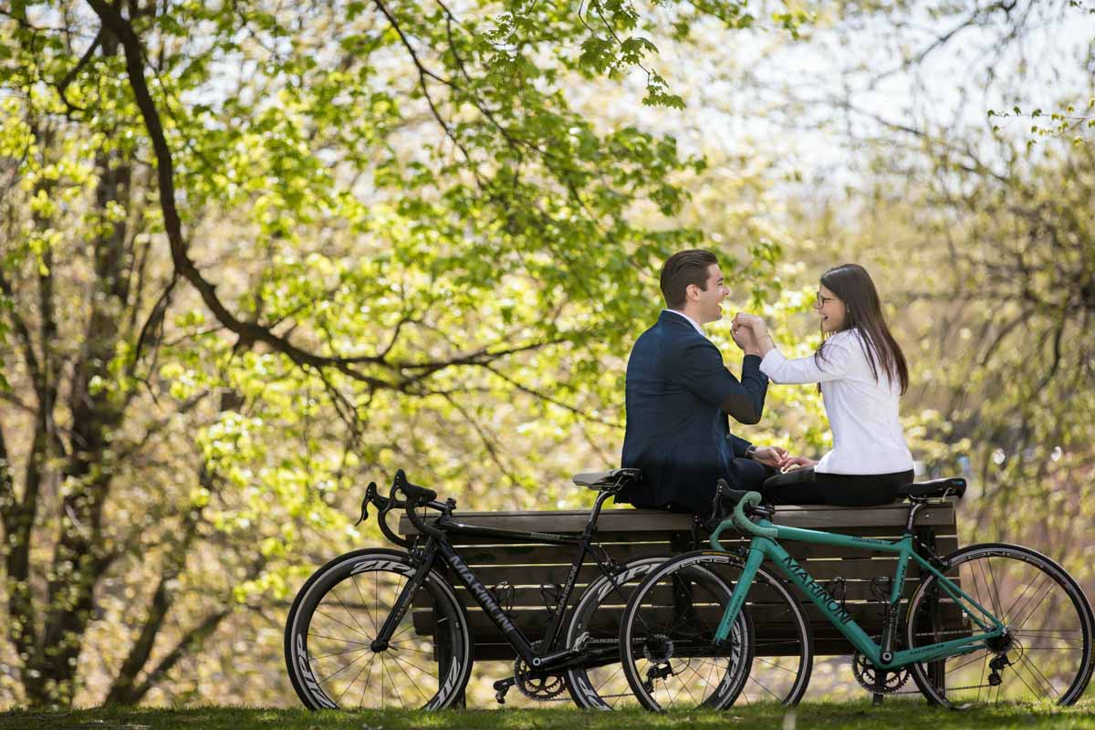 Riding bikes at La Fontaine Park Montreal engagement session