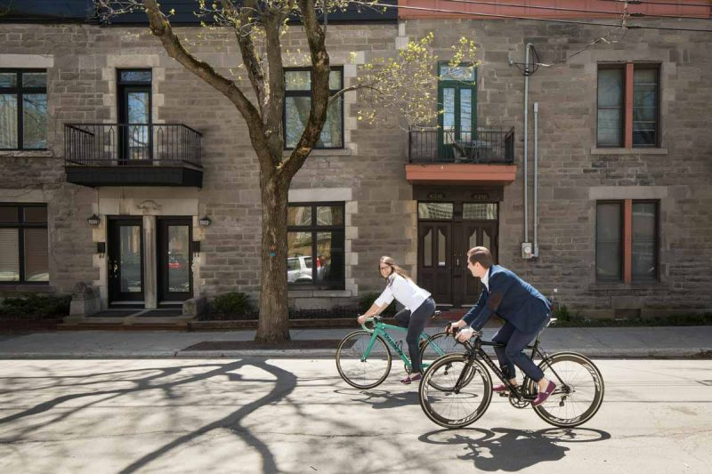 Riding bikes on the street at the plateau Montreal