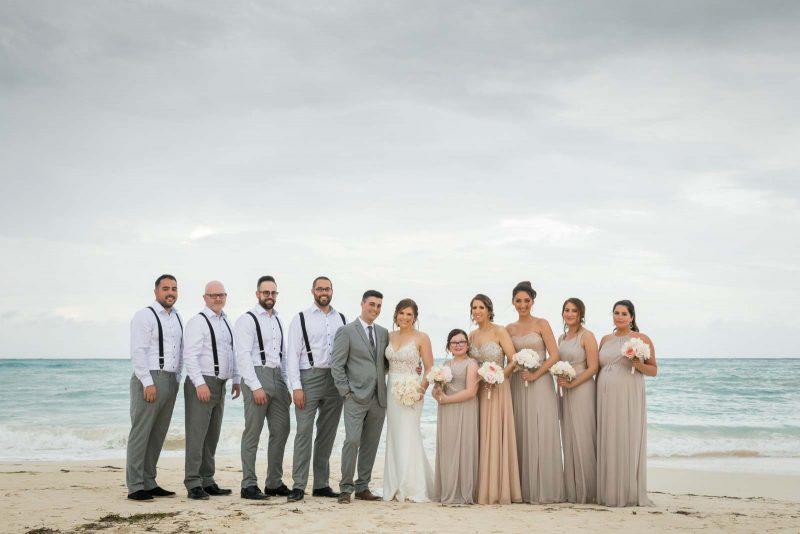 Bridal party group photo on beach