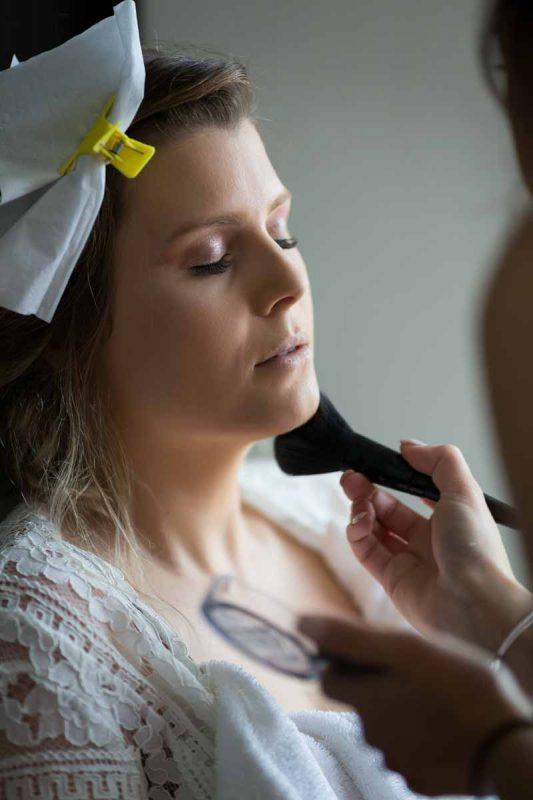 Bride getting makeup during preparation