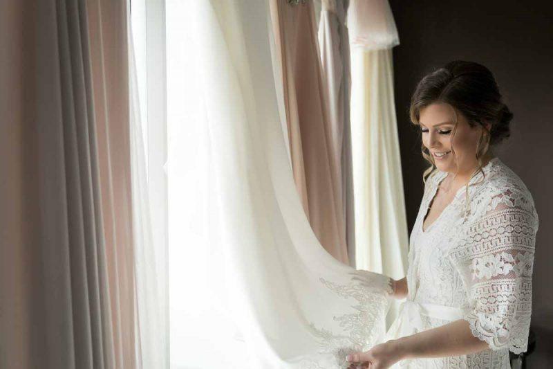Bride overlooking at wedding dress