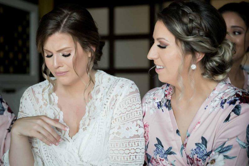 Bridesmaids crying during preparation