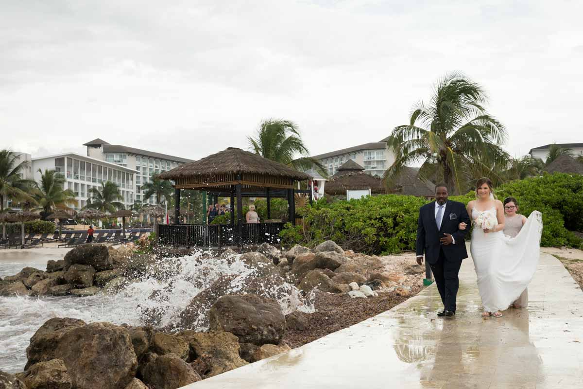 Bride walking with dad to ceremony Royalton White Sands Montego Bay Jamaica