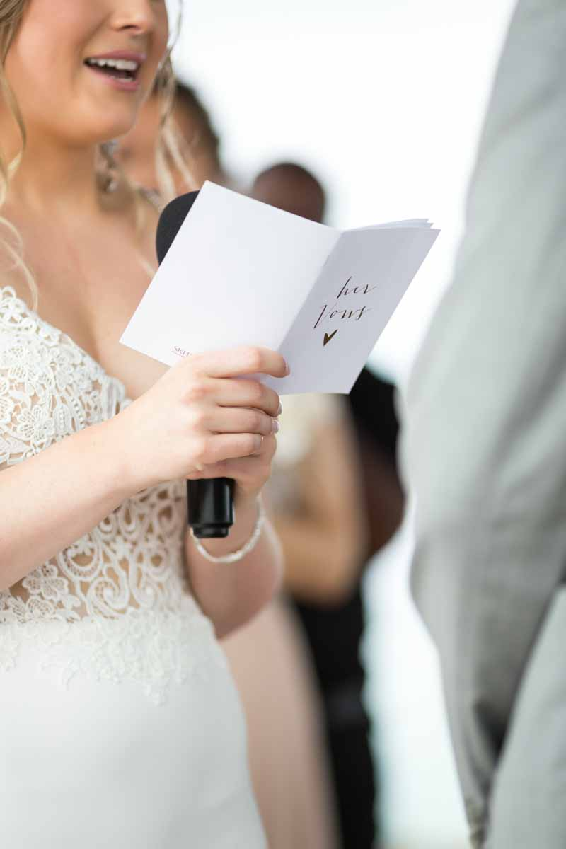 Bride reading wedding vows