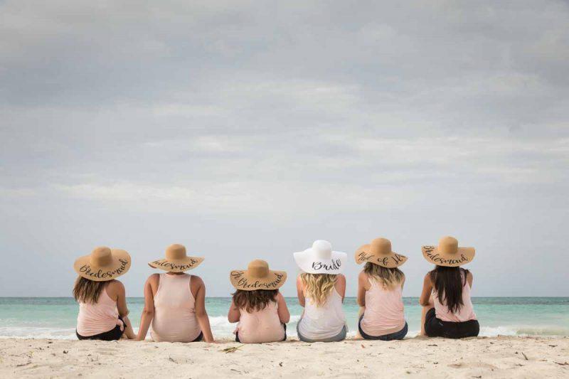 Bridesmaids looking at the beach