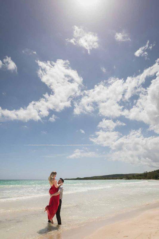 Destination wedding Jamaica Royalton White Sands Montego Bay lifting bride