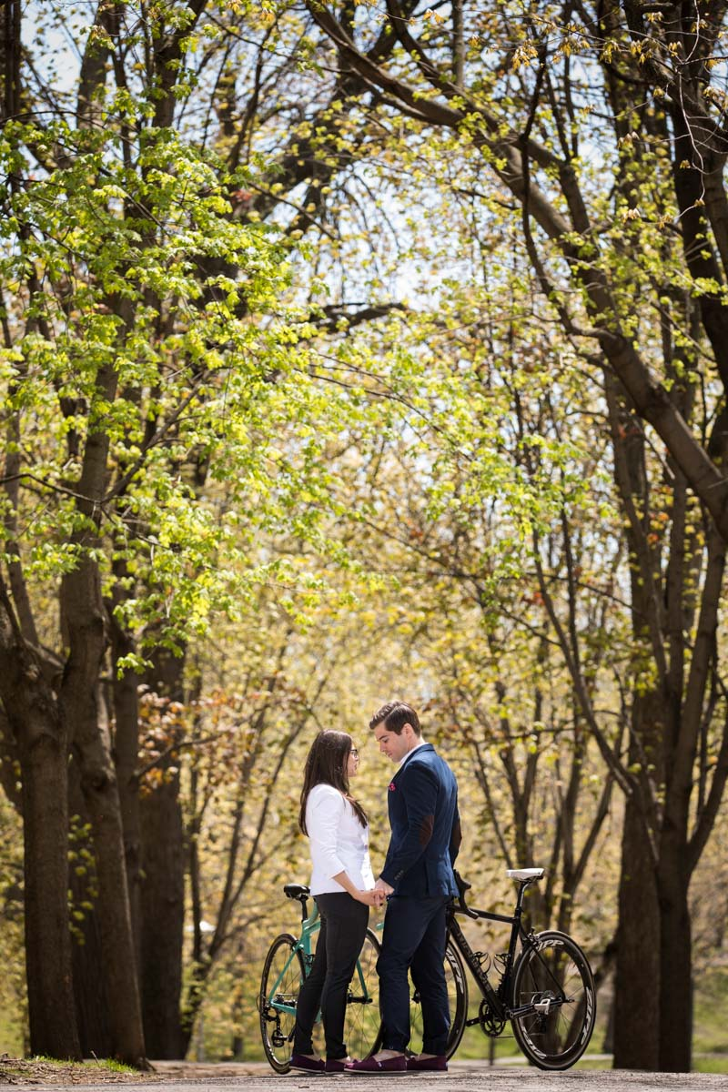 Lafontaine park engagement tall trees in spring