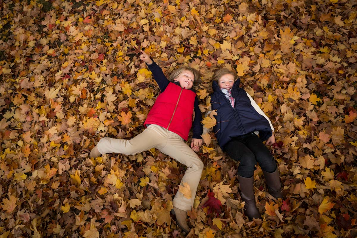 Kids on autumn leaves