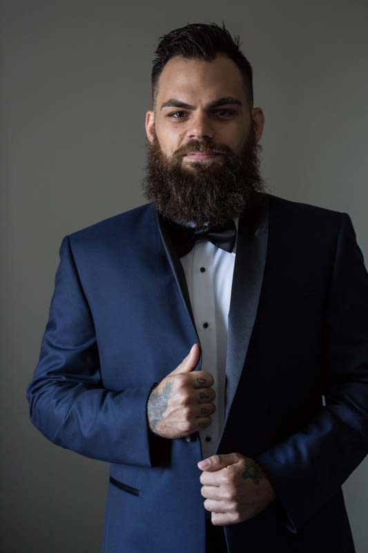 Groom posing during preparation