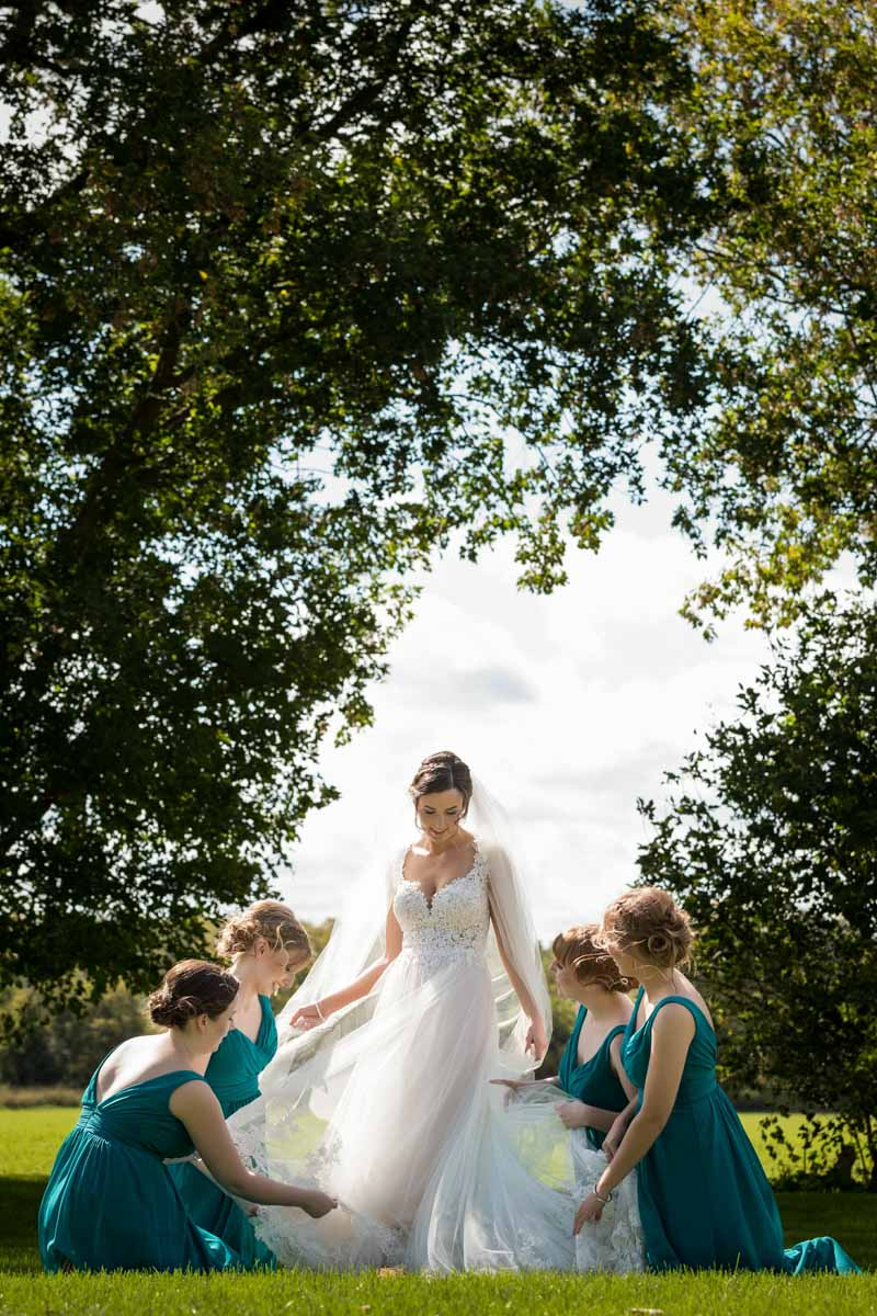 Bridesmaids posing bride's dress