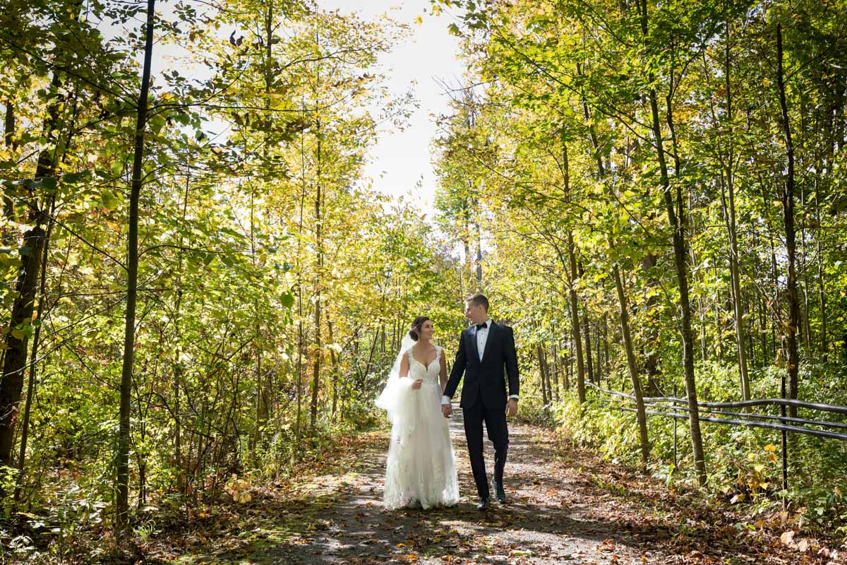 Bride and groom posing at Temples Sugar Bush Ltd