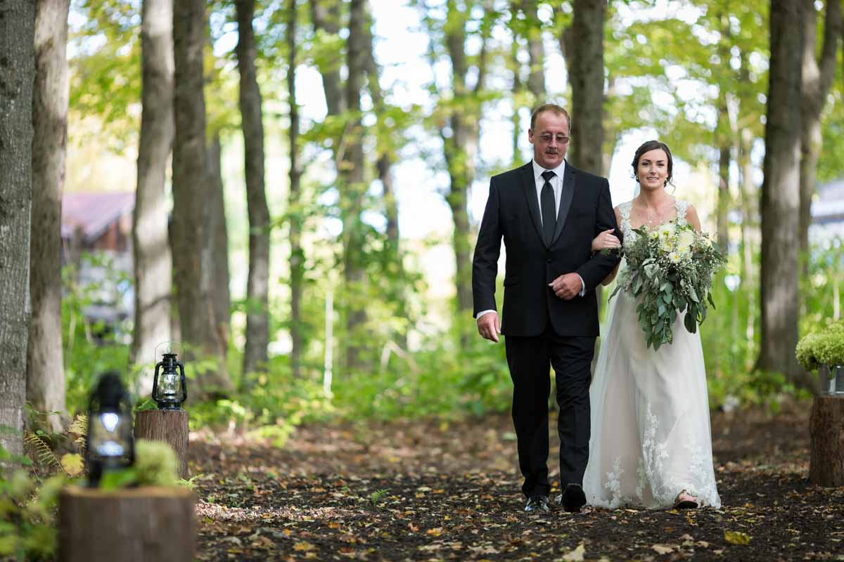 Bride walking with dad at wedding ceremony Temples Sugar Bush Ltd