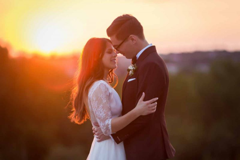 Bride and Groom catching sunset at Entrepots Dominion's rooftop on wedding day