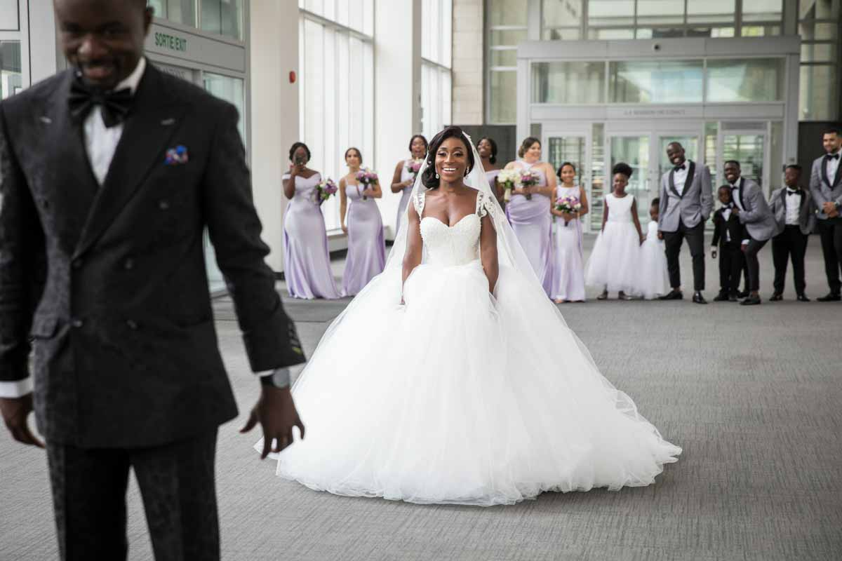 Bride walking towards groom during first look