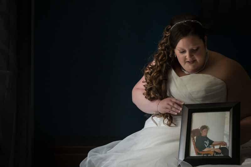 Bride holding mom's photo